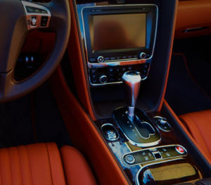 Luxury car's interior music system with dark tan leather finish