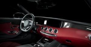 Dark red dashboard interior of a luxury car